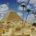 One Of The Pyramids Seen Behind An Arab by Maynard Owen Williams