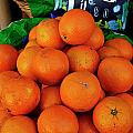 Oranges Displayed In A Grocery Shop by Sami Sarkis