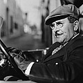 Portrait Of Man In Drivers Seat Of Car by Everett