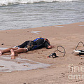 Small Surfer Lying On Beach by Christopher Purcell