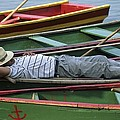 Tour Boat Guide Naps Amidst Rowboats by Raymond Gehman