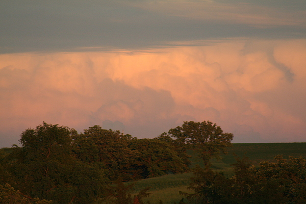Clouds Of A Distant Storm Photograph by Linda Ostby
