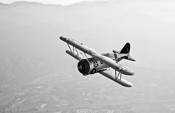 Black And White Photograph - A Grumman F3f Biplane In Flight by Scott Germain