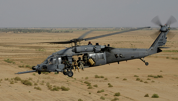 Csar Photograph - A U.s. Air Force Hh-60 Pavehawk Flies by Stocktrek Images