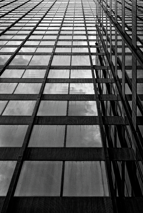 Reflections Photograph - Reflective Glass And Metal Building by Robert Ullmann