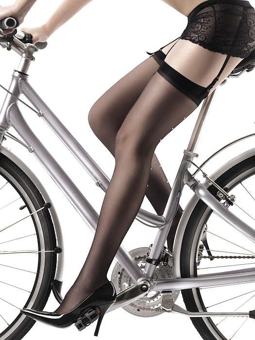 Legs Photograph - Sexy Woman Riding A Bike by Oleksiy Maksymenko
