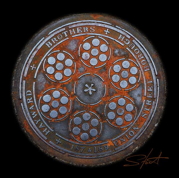 Manhole Photograph - Shield by Charles Stuart