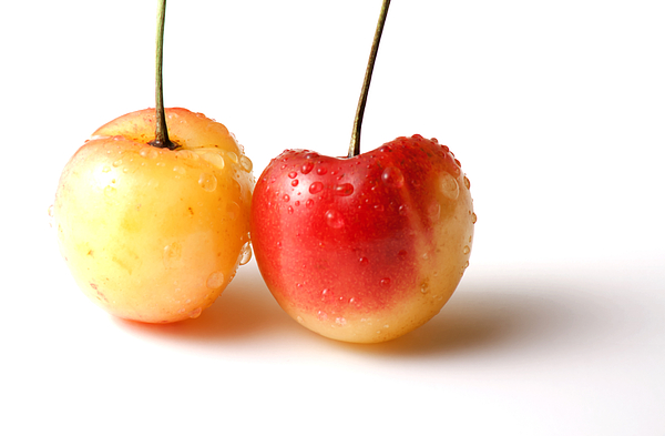 Cherry Photograph - Two Rainier Cherries by Blink Images