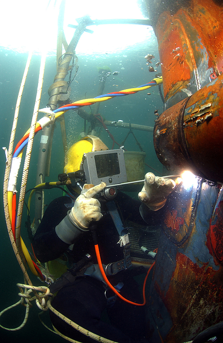 Adults Only Photograph - U.s. Navy Diver Welds A Repair Patch by Stocktrek Images