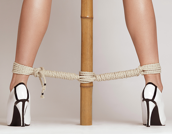 Bondage Photograph - Woman Legs Tied With Ropes To Bamboo by Oleksiy Maksymenko