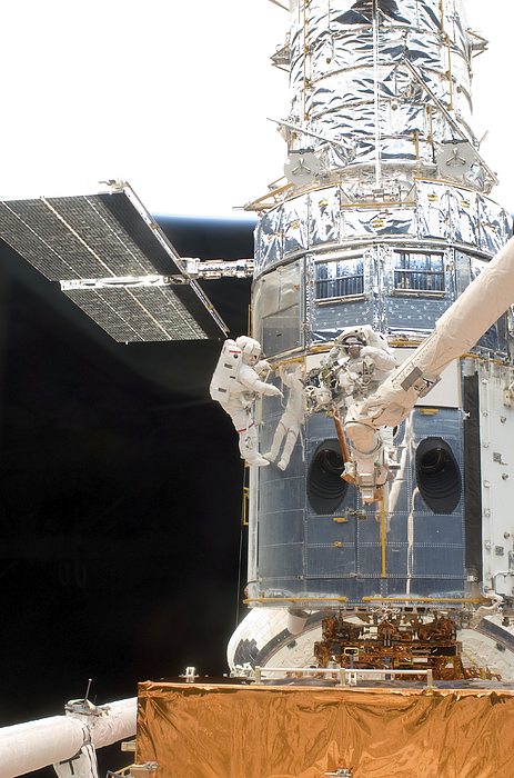 Sts-125 Photograph - Astronauts Working On The Hubble Space by Stocktrek Images