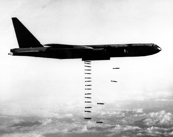 1960s Candids Photograph - A B-52 Stratofortress Releases Bombs by Everett