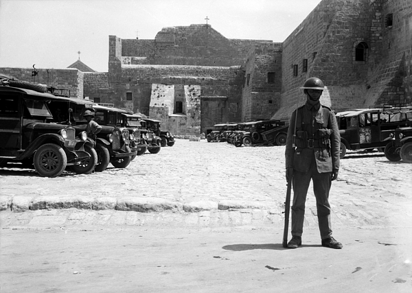 Nativity Photograph - A British Soldier In Front Of Nativity Church by Munir Alawi