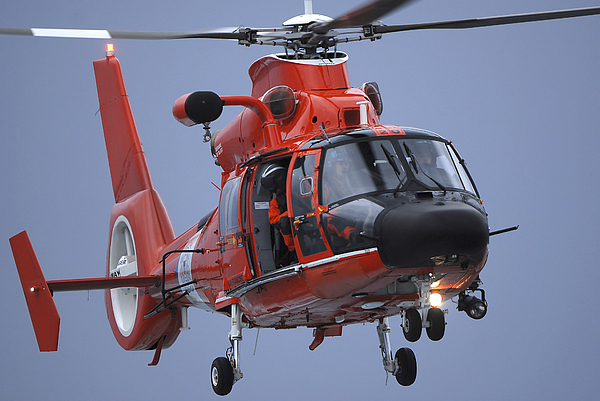Mh -65 Dolphin Photograph - A Coast Guard Mh-65 Dolphin Helicopter by Stocktrek Images