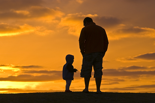 Outdoors Photograph - A Father And His Baby Son Watch by Jason Edwards