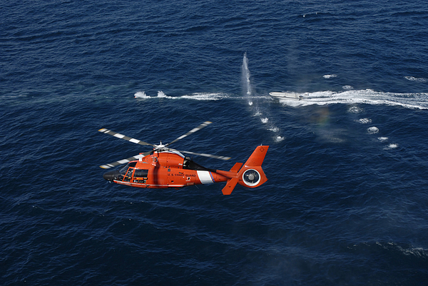 Hitron Photograph - A Helicopter Crew Trains Off The Coast by Stocktrek Images