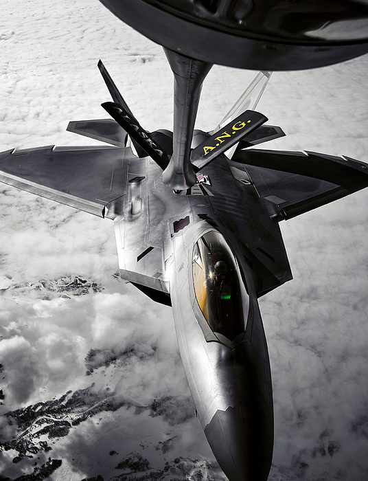Aerial Photograph - A Kc-135 Stratotanker Refuels A F-22 by Stocktrek Images