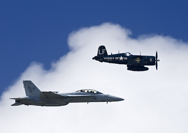 Outdoors Photograph - A Navy F-18 And A Wwii Vintage F4u by Medford Taylor