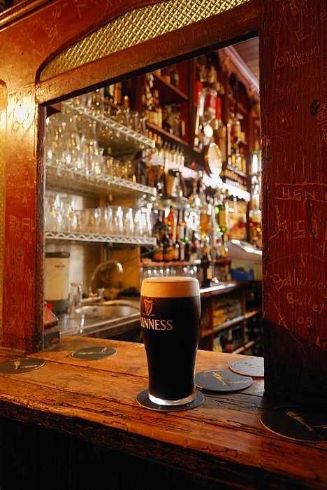 Day Photograph - A Pint Of Dark Beer Sits In A Pub by Jim Richardson