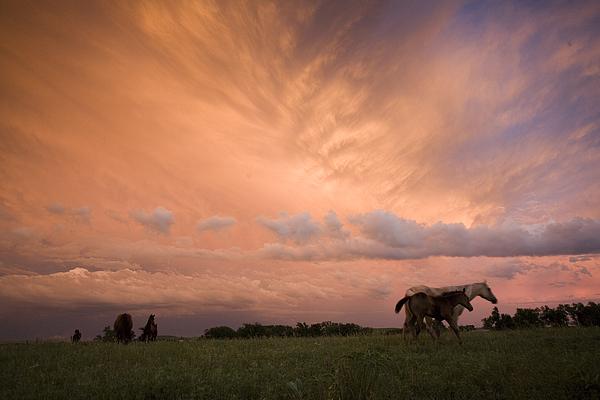 Outdoors Photograph - A Receding Thunderstorm Creates by Jim Richardson