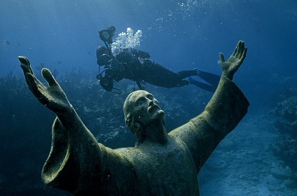 Day Photograph - A Scuba Diver Swims Past The Statue by Bates Littlehales