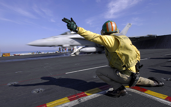 Operation Enduring Freedom Photograph - A Shooter Signals The Launch Of An by Stocktrek Images