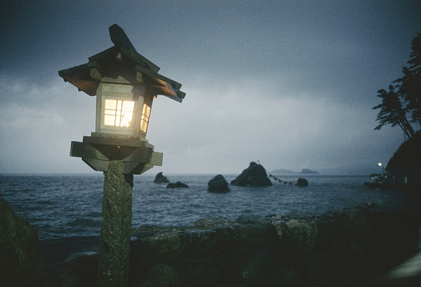 Asia Photograph - A Small Wooden Lantern Looks by Luis Marden
