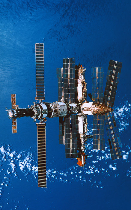 Vertical Photograph - A Space Station Orbiting In Space by Stockbyte