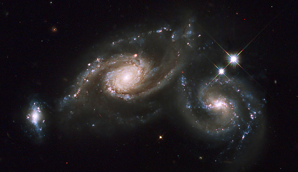 Twinkle Photograph - A Triplet Of Galaxies Known As Arp 274 by Stocktrek Images