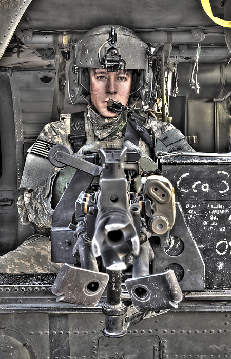 Aviation Photograph - A Uh-60 Black Hawk Door Gunner Manning by Terry Moore