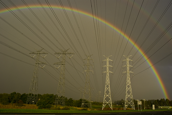Outdoors Photograph - A Vast Array Of Electrical Towers by Jason Edwards