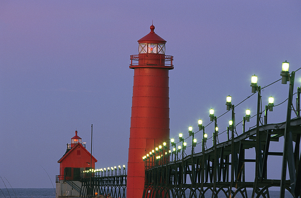 Structures Photograph - A View Of The Grand Haven Lighthouse by Ira Block