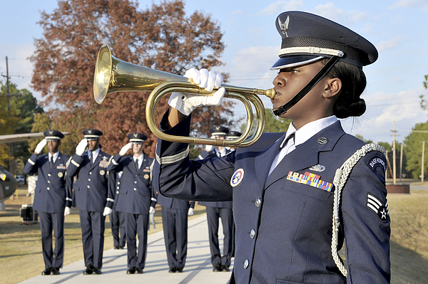 Female Photograph - Airman Plays Taps During The Veterans by Stocktrek Images