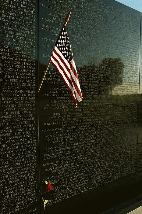 Vietnam Veterans Memorial Photograph - American Flag Left At The Vietnam by Medford Taylor