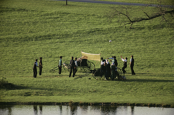 Ideologies Photograph - Amish Buggies Anchor A Volleyball Net by Ira Block