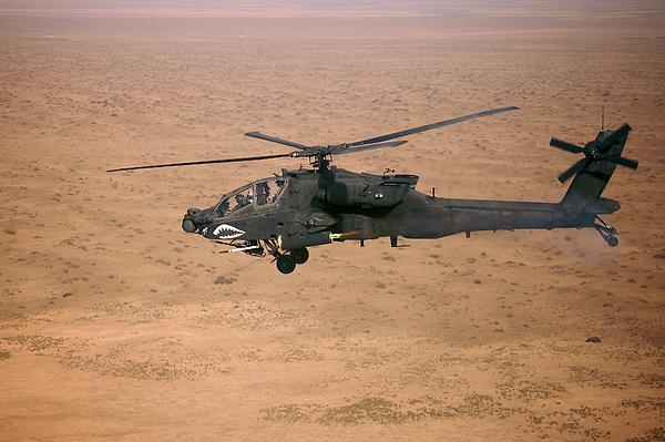 Ah-64d Photograph - An Ah-64d Apache Longbow Fires A Hydra by Terry Moore