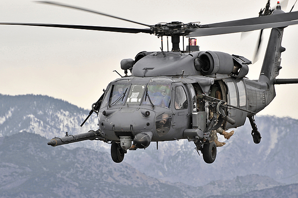 Middle East Photograph - An Hh-60 Pave Hawk Helicopter In Flight by Stocktrek Images