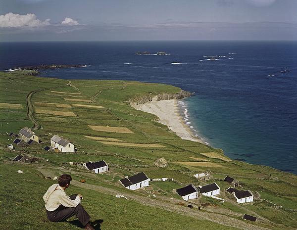 Great Blasket Island Photograph - An Irishman Overlooks Cottages That by Howell Walker
