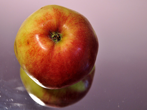 Apple On Icy Background Photograph by Lucia Timbell