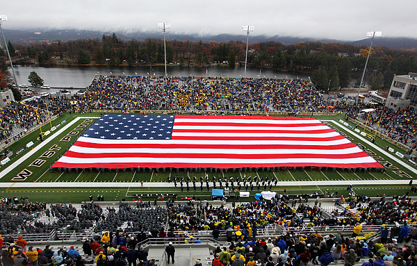 Army Photograph - Army An American Flag Spans Michie Stadium by Associated Press