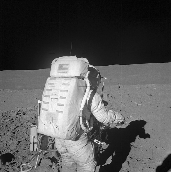 Black And White Photograph - Astronaut Walking On The Moon by Stocktrek Images