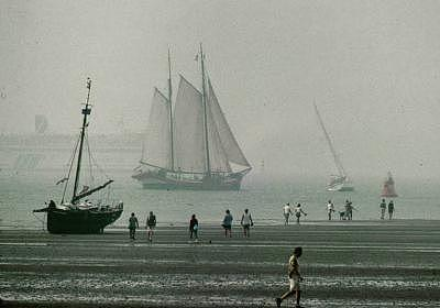 Seascape Photograph - Beached Ship And People by PJ Steinmeijer