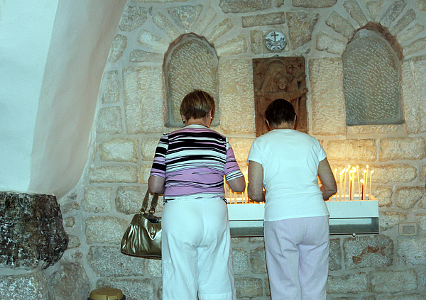 Bethlehem Photograph - Bethlehem - Milk Grotto Church Lighting Candles by Munir Alawi
