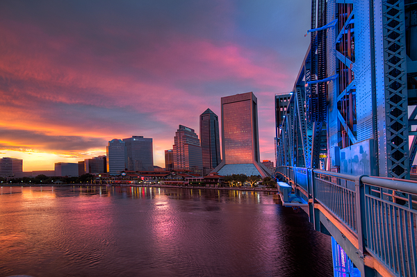 Clouds Photograph - Blue Bridge Red Sky Jacksonville Skyline by Debra and Dave Vanderlaan