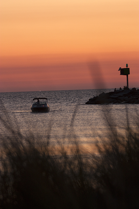Vertical Photograph - Boat Arriving At New Buffalo Harbor by Christopher Purcell