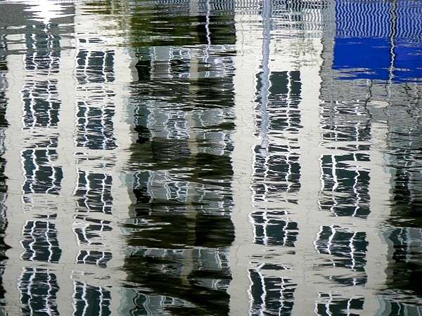 Water Photograph - Building Reflection In Water by Kaarin  Keil