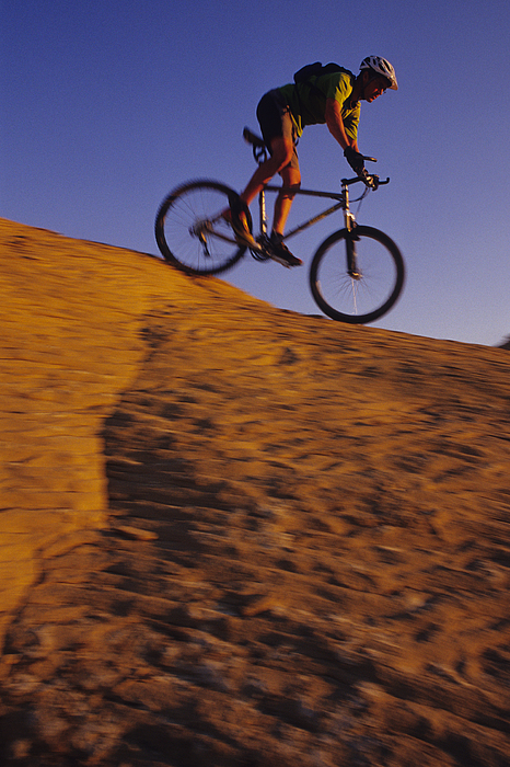Adventure Sports Photograph - Caucasian Male Mountain Biking by Bobby Model