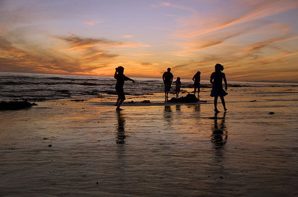 Usa Photograph - Children Playing On The Beach At Sunset by James Forte