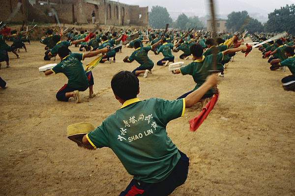 Asia Photograph - Children Practice Kung Fu In A Field by Justin Guariglia
