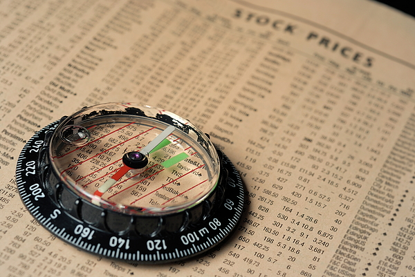 Information Photograph - Compass On Stockmarket Cotation In Newspaper by Sami Sarkis